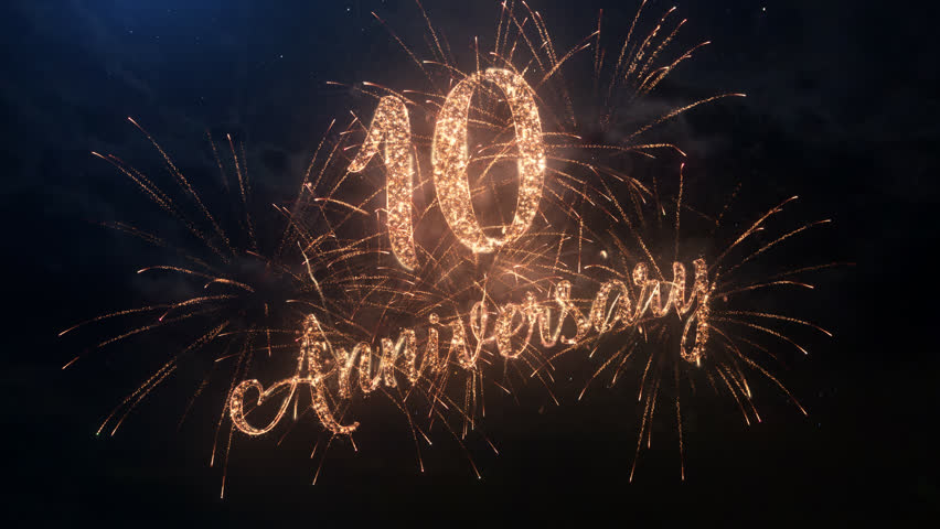 Happy birthday Anniversary 10 years celebration greeting text with particles and sparks on black night sky with colored slow motion fireworks on background, beautiful typography magic design. | Shutterstock HD Video #24176416
