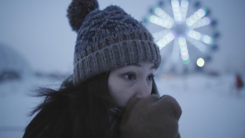 Girl freezes in winter street at evening | Shutterstock HD Video #24177976