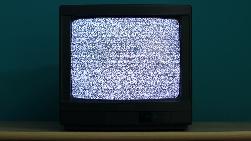 Static noise on an old TV in a dim room