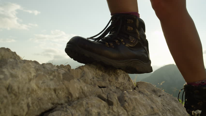 SLOW MOTION, CLOSE UP: Detail of vintage leather mountaineering boots. Unrecognizable adventurous female hiker climbing rocky mountains and walking uphill on amazing sunny summer day in European Alps #24178579