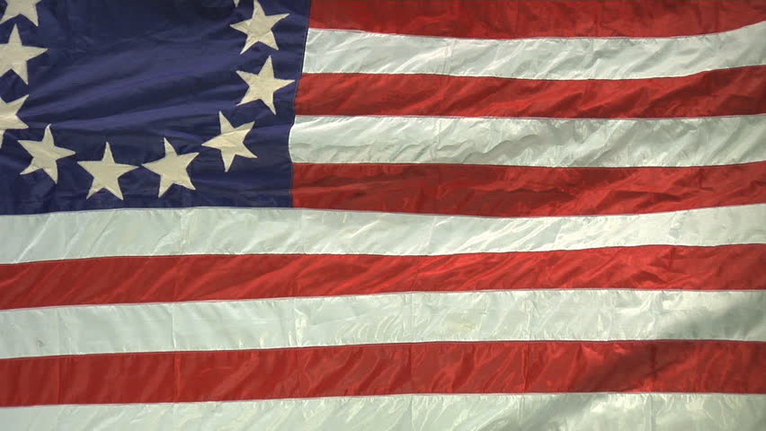 VIRGINIA - OCTOBER 2016 - Patriotic, American Revolutionary War era flag 13-stars, Betsy Ross style.  July 4th red, white & blue, stars and stripes flag against green screen background.  13 Colonies