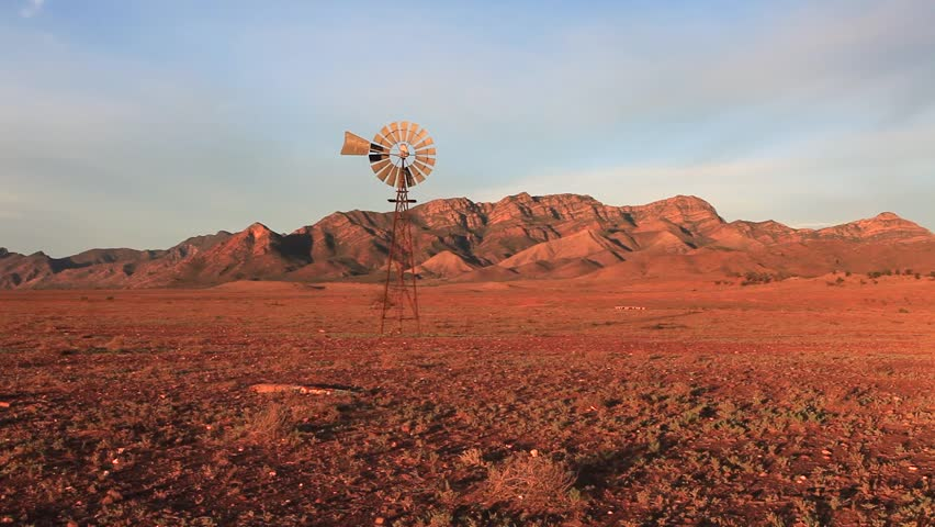 A windmill turns in outback Australia. This windmill is located in the Flinders Ranges National Park a few hours drive north of Adelaide, South Australia.