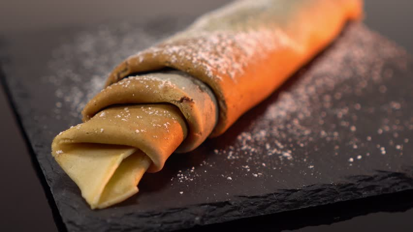 French Crepe filled with chocolate - sweet pancake dessert from France | Shutterstock HD Video #24200896