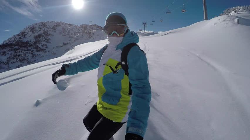 SELFIE CLOSE UP: Snowboarder riding powder snow off piste in sunny ski resort | Shutterstock HD Video #24202612