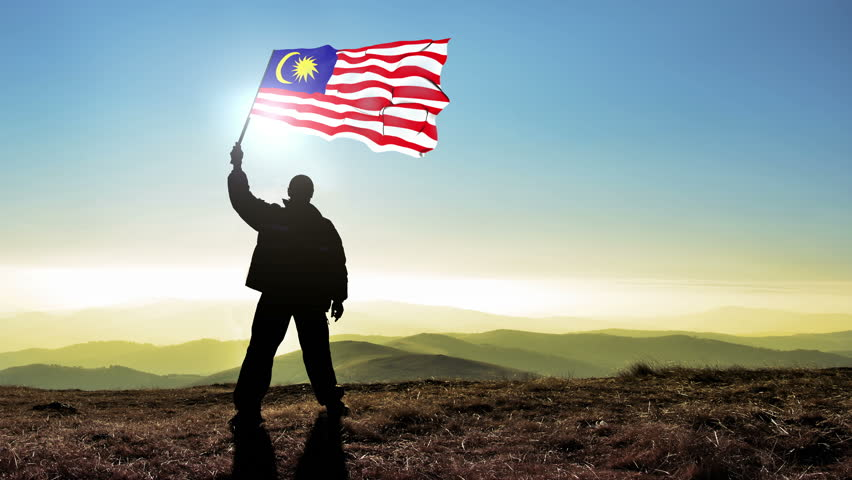 Successful silhouette man winner waving Malaysia flag on top of the mountain peak, Cinemagraph LOOP background #24222952