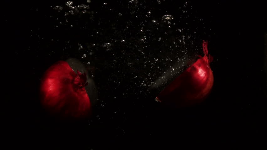 Two halves of red onion fall in an empty aquarium | Shutterstock HD Video #24232235