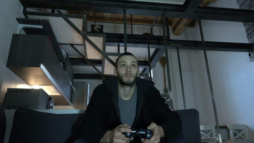 Young Man play with Videogames in Modern Apartment   Shutterstock HD Video #24237026