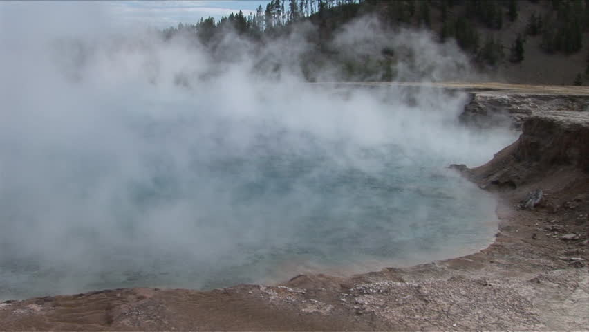 View of geyser steam in Yellowstone National Park Wyoming United States