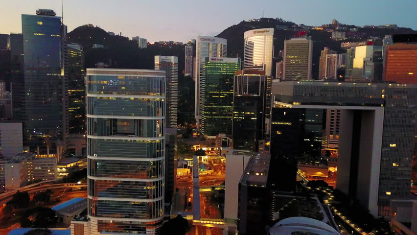 Aerial view of Hong Kong city at early morning time. Blurred all brand mark. Cinematic style.