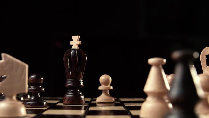 Pawn King beats. chess closeup, wooden chess board, business concept, black background. slide camera. Studio. Hand made chess   Shutterstock HD Video #24272645