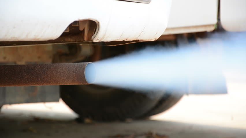 Car exhaust fumes, Acceleration engine,exhaust fumes are white,It was an old car,Cause global warming.