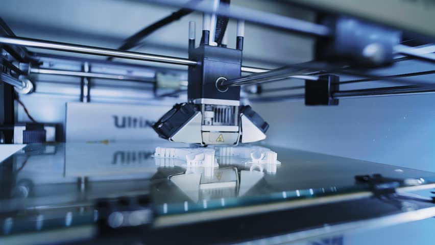 Super close focus on micro 3d printer head at work, printing small details with white filament, quickly moving inside glass box, futuristic shot. Industrial business concept, left side view Royalty-Free Stock Footage #24284129