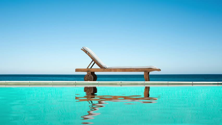 Seamless loop - Reclining chair near a swimming pool, sea and blue sky, water reflections, video HD | Shutterstock HD Video #24290201