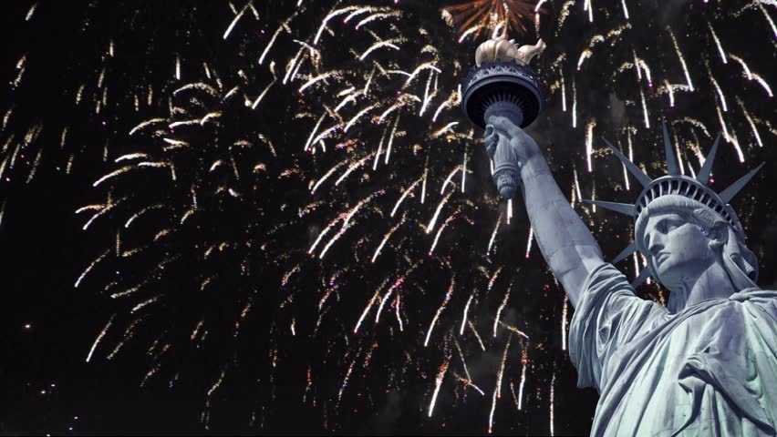 Seamless loop - Statue of liberty, night sky with fireworks - New year, national holiday celebration concept in New Year, US - HD video