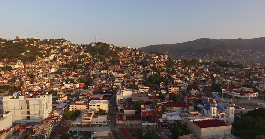 4K drone aerial of a busy port and barrios of Acapulco, Mexico