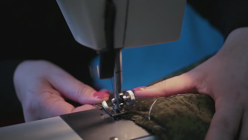 girl sitting at the sewing machine and sew clothes flower hacks do zigzag, slow motion, HD, 1920x1080. #24310910