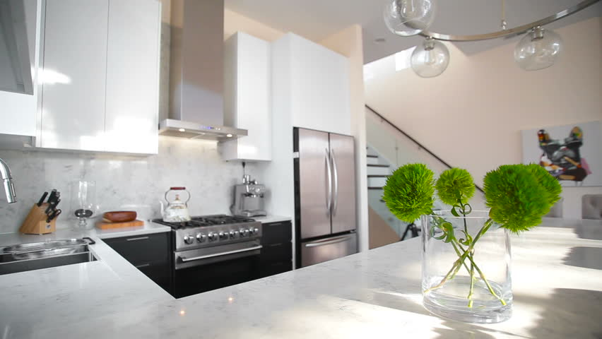 White modern kitchen in a house with a beautiful design