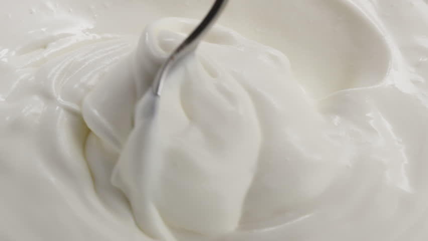 Slow motion of mixing yogurt with spoon, 180fps  | Shutterstock HD Video #24330413