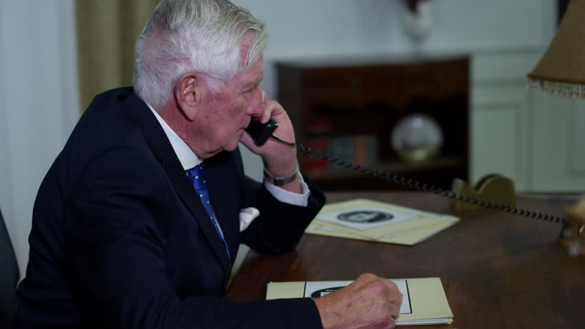 United States President on phone in oval office