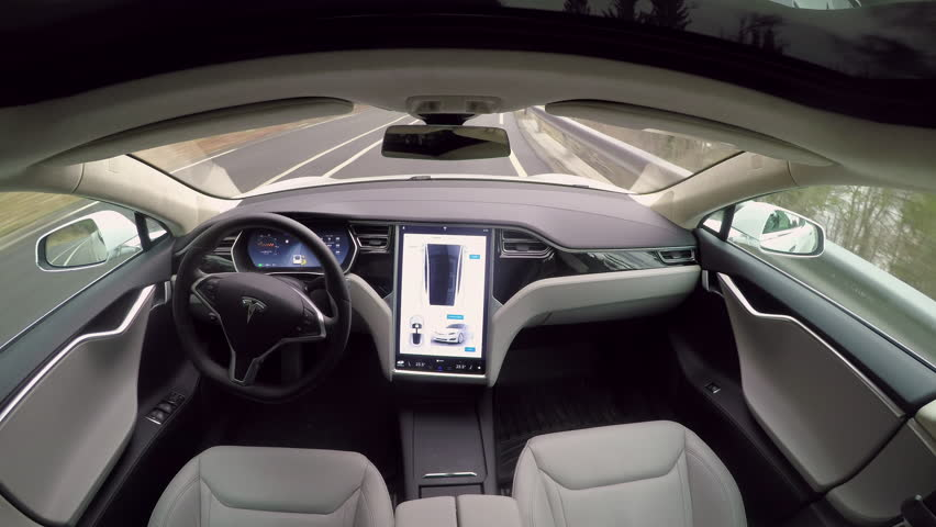 AUTONOMOUS TESLA CAR, FEBRUARY 2016:  Absolutely autonomous self-driving Tesla Model S autopilot and trully driverless car with empty seat and no driver. Next gen ultrasonic sensors, cameras and radar