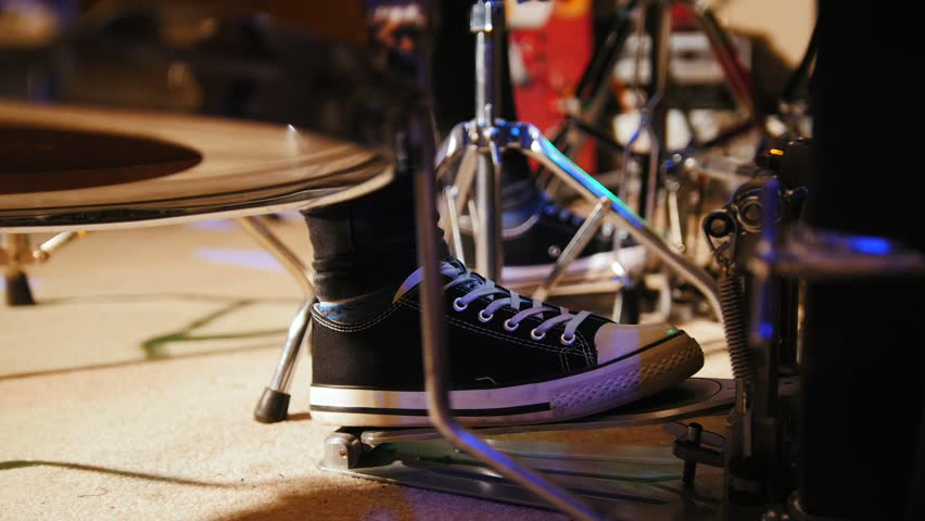 Drummer's foot in sneakers moving drum bass pedal | Shutterstock HD Video #24388220