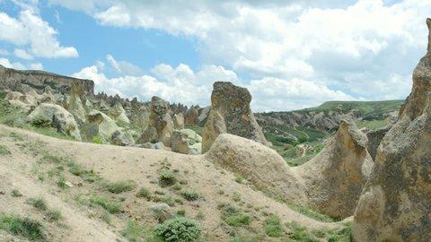 Famous Cappadocia rock formations, slow panning movie. Turkey.