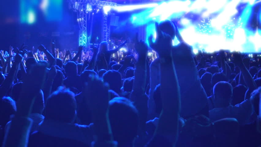Happy crowd of people jumping in euphoria, enjoying good music at rock show | Shutterstock HD Video #24399386