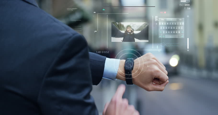 A man answers the wife who smiles and waves from the phone that appears in hologram clock futuristic and technological. Concept: holiday, communication,family, technology, augmented reality and future | Shutterstock HD Video #24409103