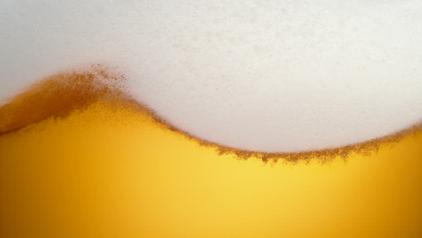 Extream close-up beer in glass. Foam moving. Shot with high speed camera, phantom flex 4K. Slow Motion. #24422699
