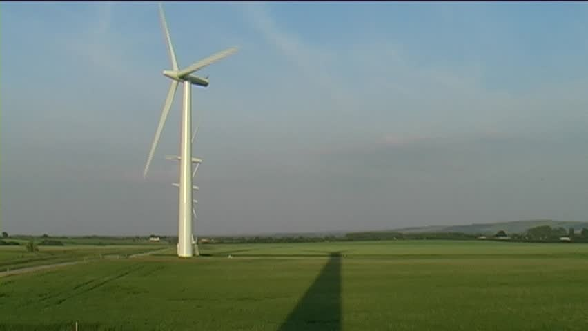 A wind farm in the english countryside on a summers evening.