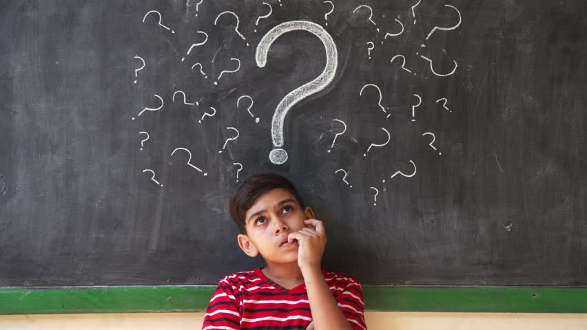Concepts on blackboard at school. Young people, quiet student and pupil in classroom. Hispanic boy with doubts and thoughts in class. Portrait of male child thinking  | Shutterstock HD Video #24452198