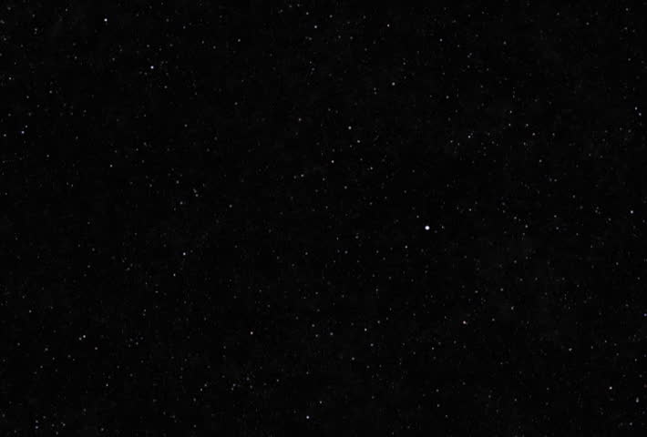 Slow tilt-up to view a black sky with small scattered stars   Shutterstock HD Video #24453920