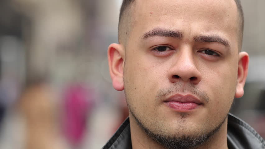 Young Hispanic man in city portrait serious face #24457805