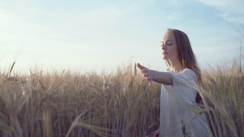 Beautiful woman in a wheat field | Shutterstock HD Video #24461912