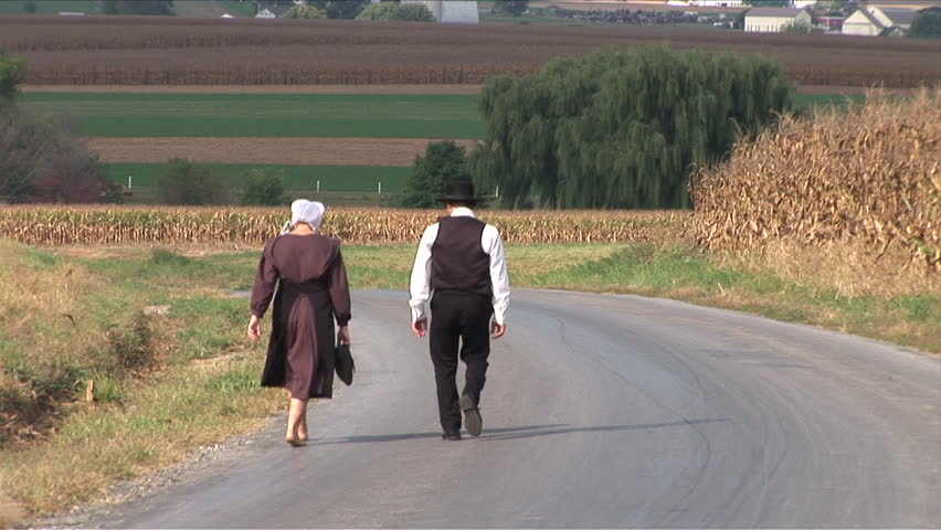 Amish couple walking down the road