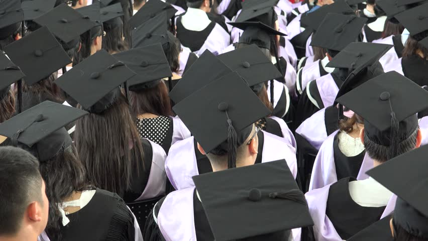 Selective Focus On Graduation Cap Of Front Female Graduate In Commencement Ceremony Row. taken on November, 2015 | Shutterstock HD Video #24495854