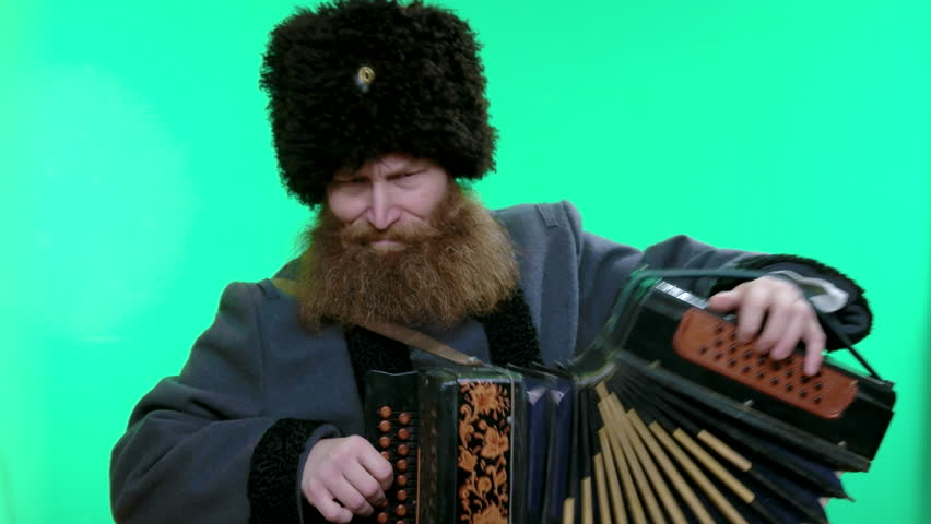 Cossack in hat playing Russian garmoshka, traditional music. Stylish bearded man. Chroma key. Handsome Bearded Man Stylish Hair Beard.