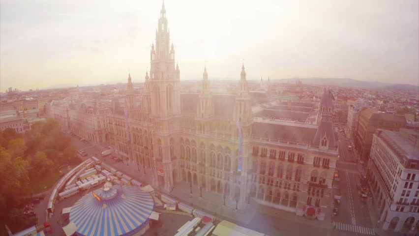 Aerial close-up Rathaus in Vienna, City Council fly over, tourism in Europe. Baroque architecture in urban world, flying over government building, travel sight seeing place in Austria