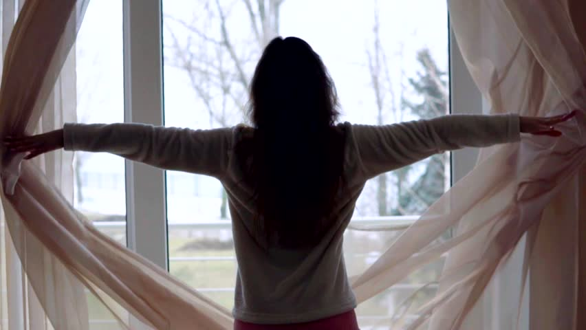 Young woman in sleeping costume opening the curtains in the morning at home #24515921