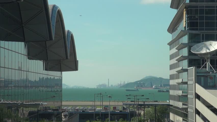 HONG KONG - JULY 28: Plane lands at Hong Kong airport on July 28, 2010 in Hong Kong, China.