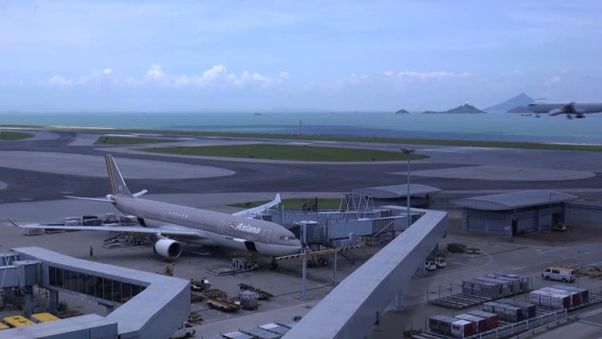 HONG KONG - JULY 28: An airplane of Cathay Pacific lands on the runway of Hong Kong International Airport (Chek Lap Kok) on July 28, 2010 in Hong Kong, China