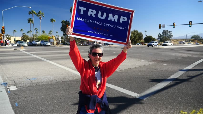 A woman waiving a sign in support of President Donald Trump