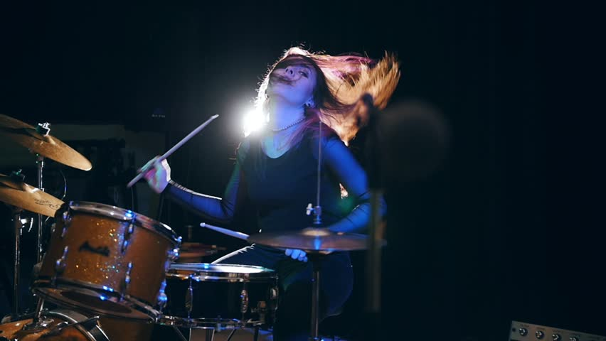 Close up view of girl rock musician- female drummer, slow-motion