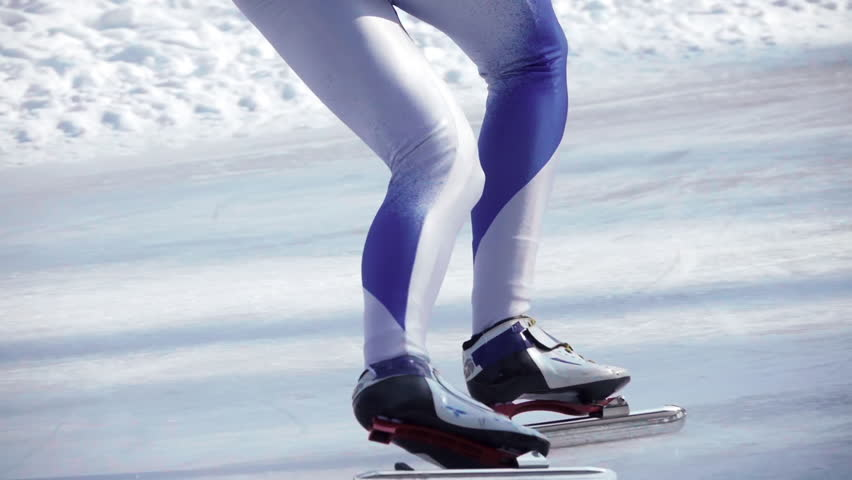Speed ice skater skating on outdoor race on turn HD slow-motion video. Close-up view of professional athlete legs training for winter olympic. Lower body back view. Royalty-Free Stock Footage #24551717