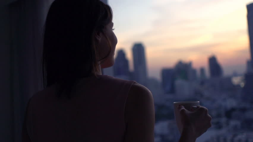 Happy woman with beverage admire view from window, super slow motion 240fps  | Shutterstock HD Video #24555491