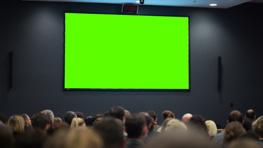 Public event. A huge space of the room is filled with persons from political or financial organization looking at green screen. Concept of common accessibility of information. Chroma key and advertise Royalty-Free Stock Footage #24558065