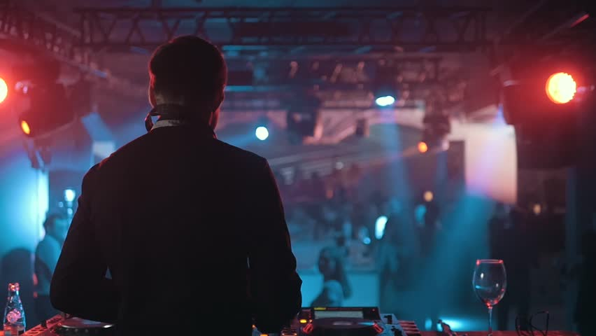 DJ Turns The Records at The Modern Nightclub, Back View, Slow Motion   Shutterstock HD Video #24574988