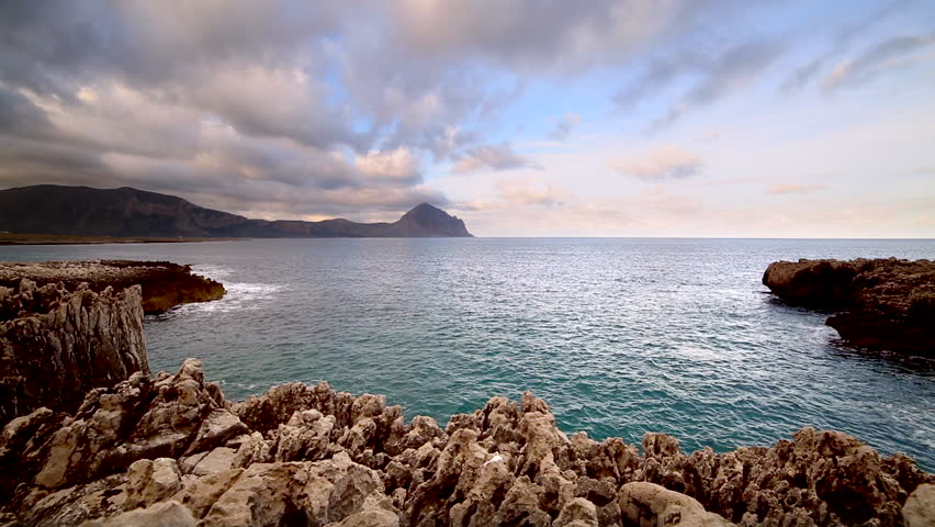 Great view of the nature reserve Monte Cofano. Location place cape San Vito, Sicilia island, Italy, Europe. Mediterranean and Tyrrhenian sea. Dramatic and unusual scene. Discover the world of beauty.   Shutterstock HD Video #24602306