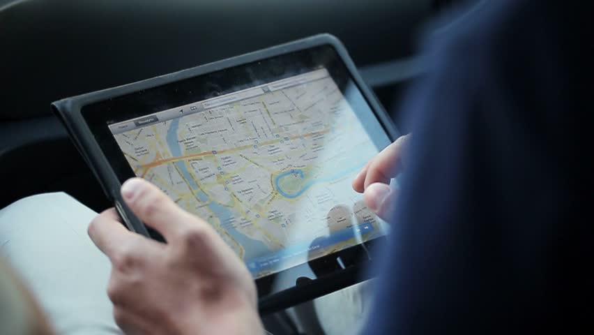 Man watching map on tablet in car | Shutterstock HD Video #24612302