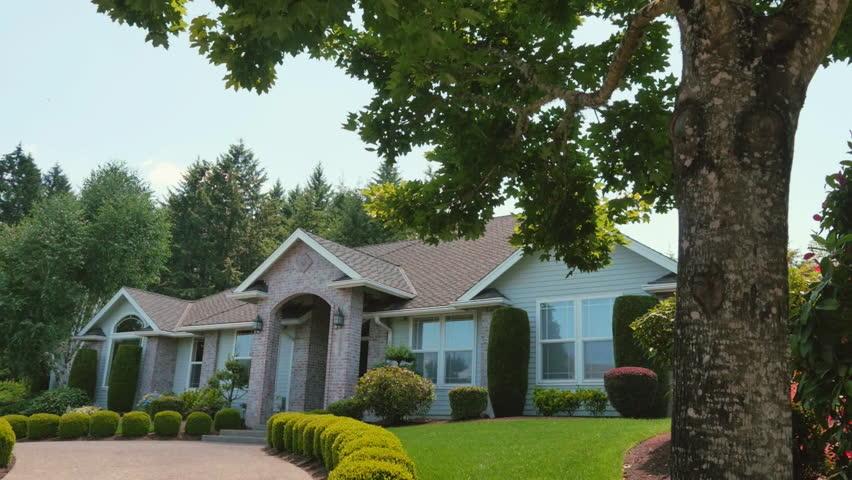 A beautiful suburban home slider shot in a very nice neighborhood on a sunny, blue sky day | Shutterstock HD Video #24615074